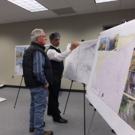 Two people reviewing project maps